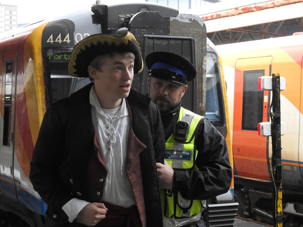 A pirate is apprehended by a Rail Community Officer at a South Western Railway station