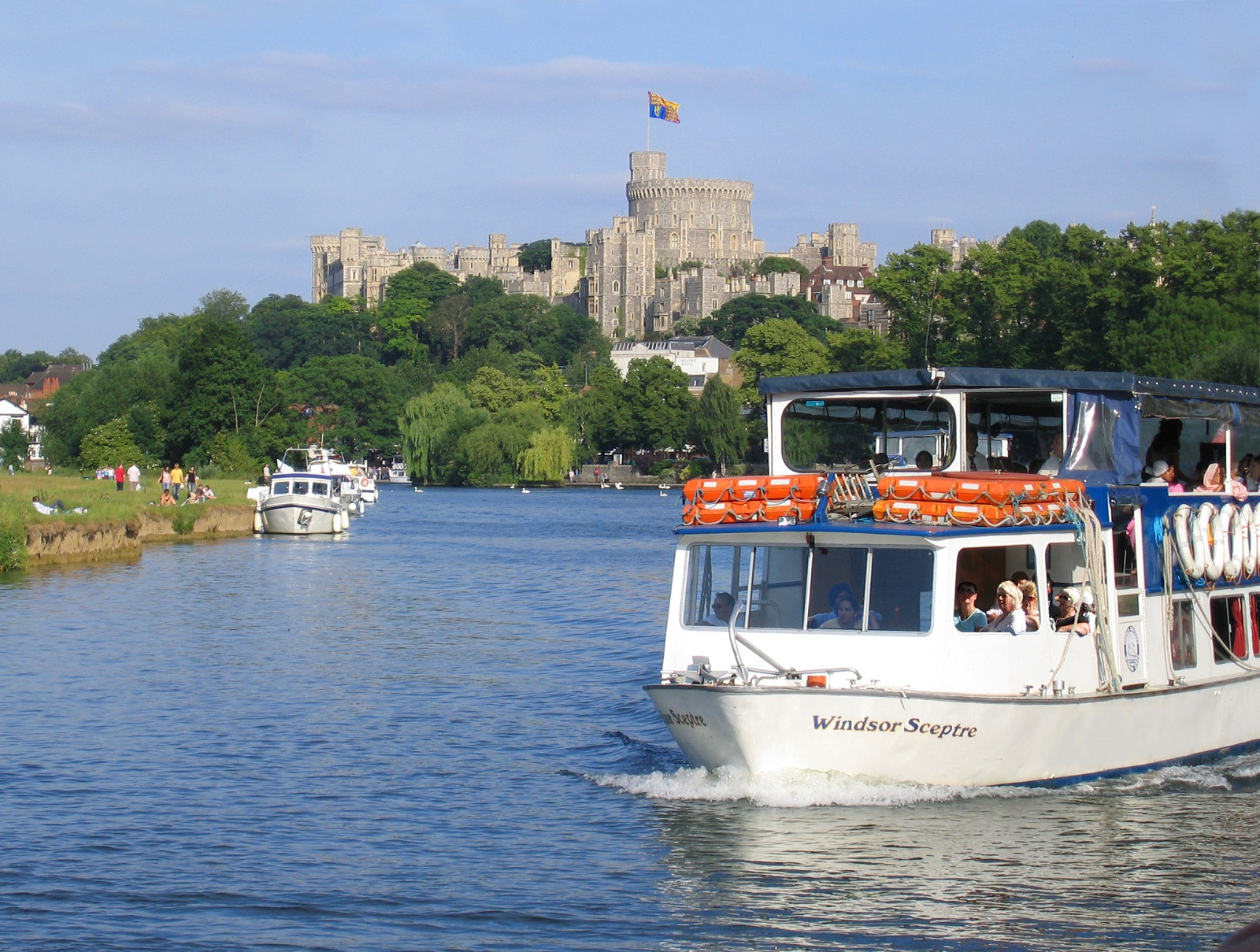 A boat - the Windsor Sceptre - travels on the river with Windsor Castle in the background. Photo is credit windsor.gov.uk
