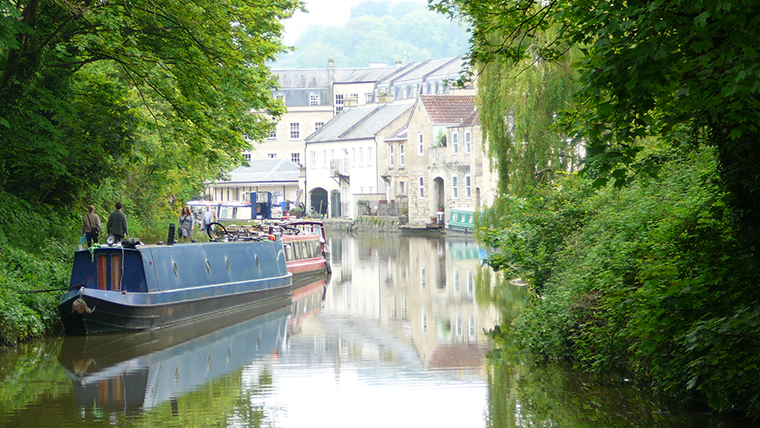 The Kennet and Avon Canal near Bath. A narrowboat is moored on the left.