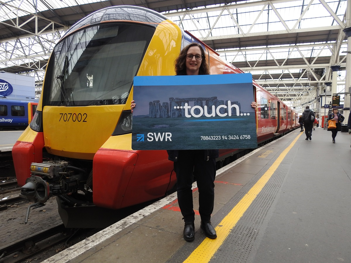 Fiona Whyte, March winner of the Renew Without the Queue Annual Season ticket prize, holding a novelty oversize smartcard